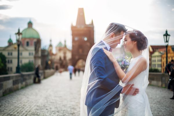 Groom and Bride on Charles Bridge in Prague